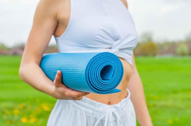 woman leaving yoga class