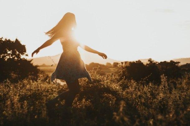 girl dancing in the sun