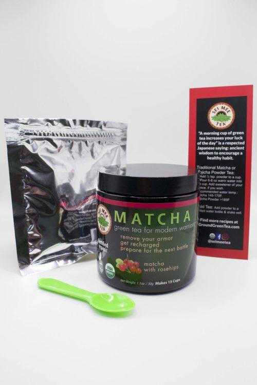 Matcha rosehip jar contents with card