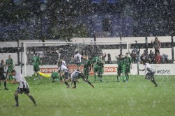Both sets of players react after Spennymoor Town (black and white) equalise against Burscough
