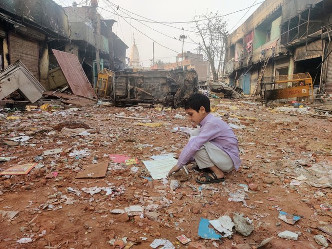 Little Imraan came out of his home in Mustafabad after three days to look for his favorite notebook.