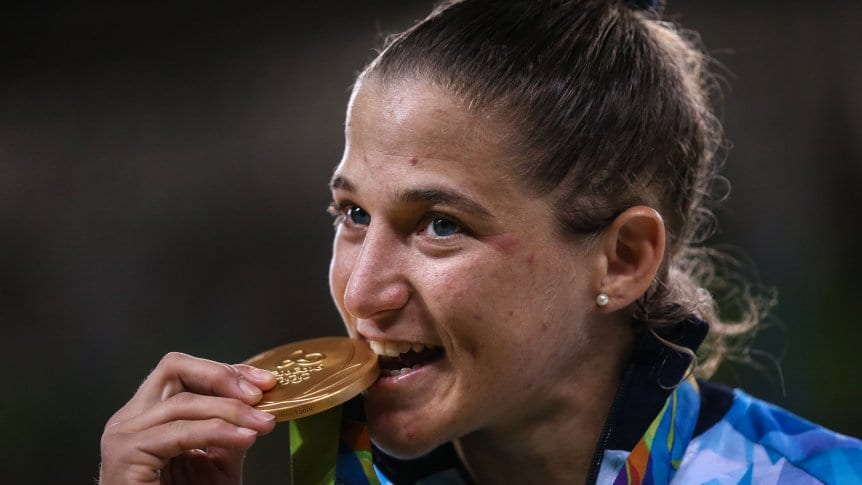 Why athletes bite their medals