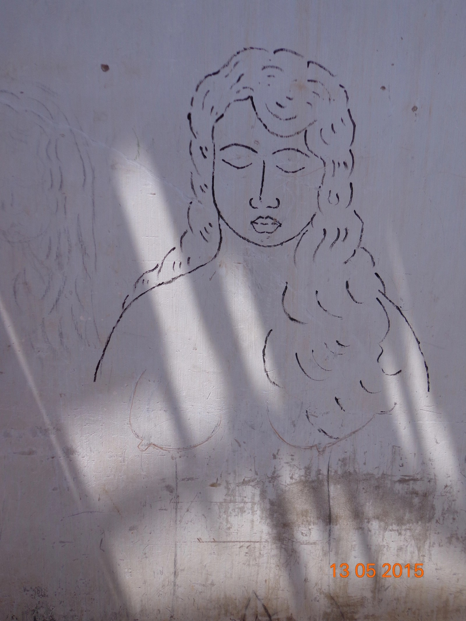 Drawings on walls of damaged houses-2