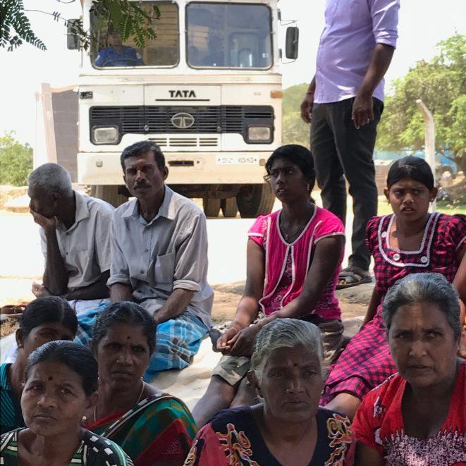 Navy school bus pass protestors as they drop Mullikulam displaced children back to Malankaadu
