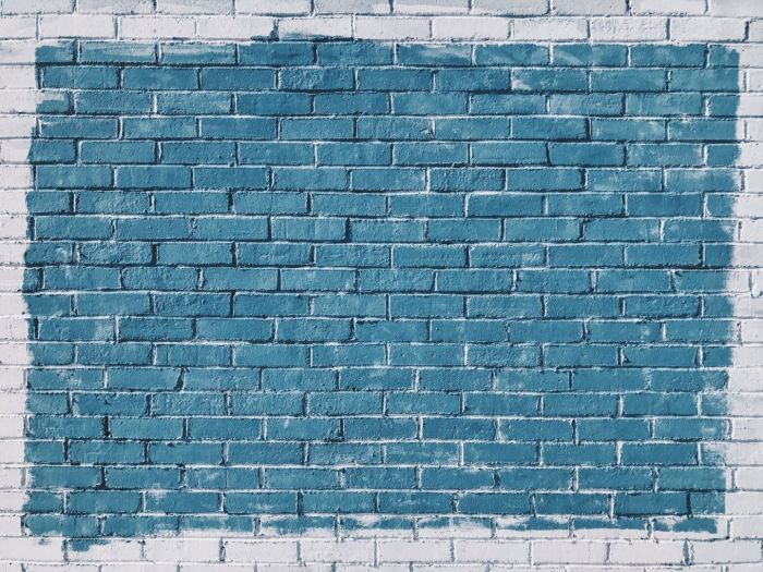 Big blank brick wall, painted dull blue with a plain grey border