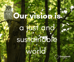 Tall forest trees with an owl looking at you while siOur vision is a just and sustainable world on a background image of tall forest trees with an owl looking at you