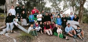 Group of people under trees in Australian bush