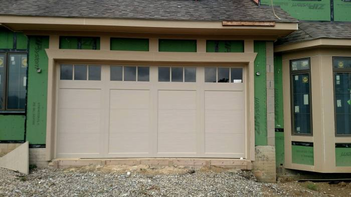 tan garage door with windows