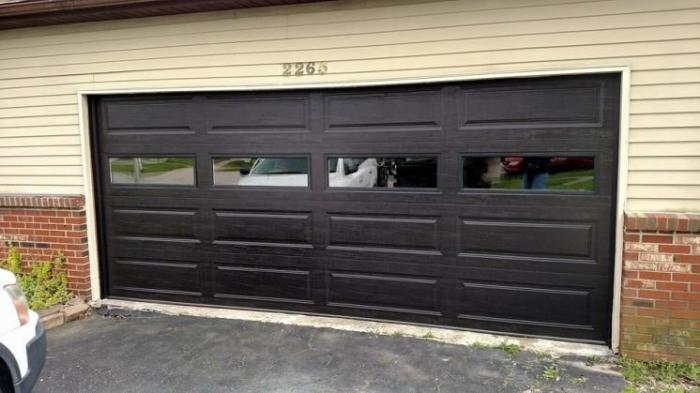 Black garage door with windows