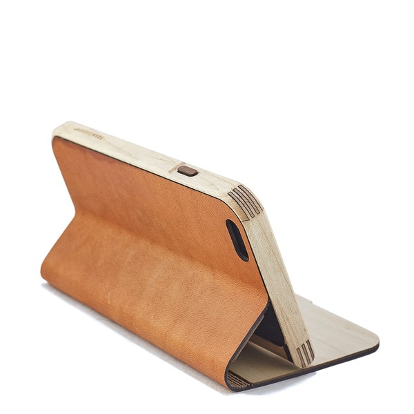 the grovemade leather cover doubles as a stand