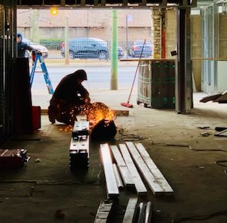 Midway received a new front facade. Gotta love the welders!