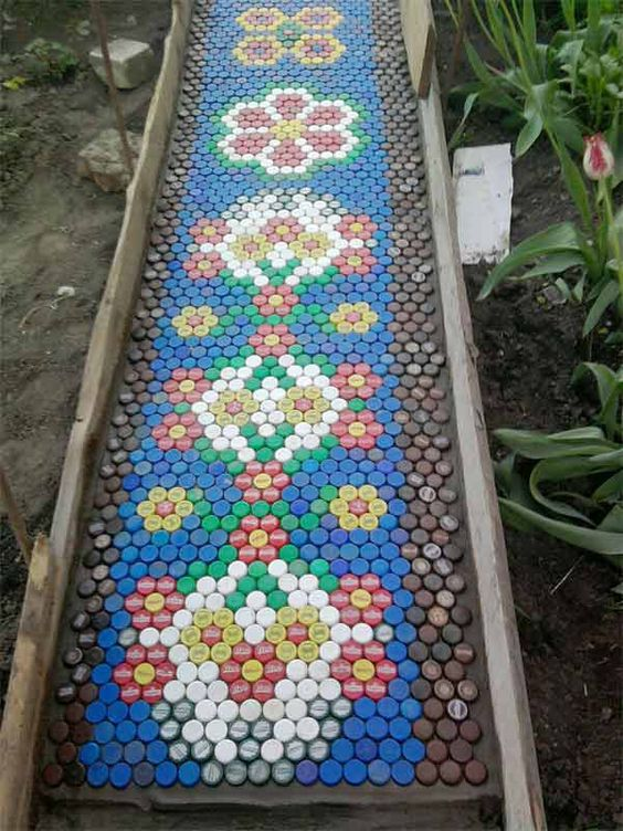 Garden Craft with bottle tops. Learn how to make this awesome bottle top art for kids in the garden. Just upcycle some plastic bottle tops and use your imagination.