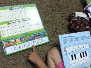 """We added some extra stickers from """"Lady Treble"""" to her Dora piano."""