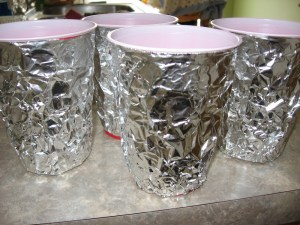 Our homemade goblets, foil hot-glued to solo cups.