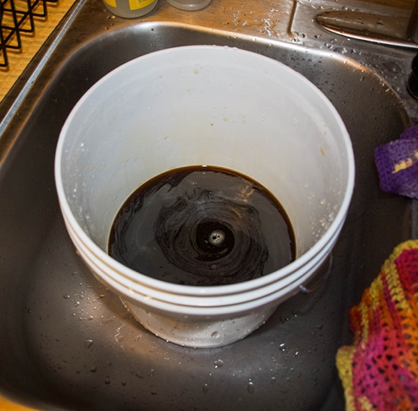 adding molasses to compost tea