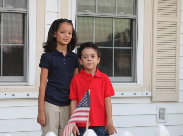 Hispanic boy and girl in school uniform