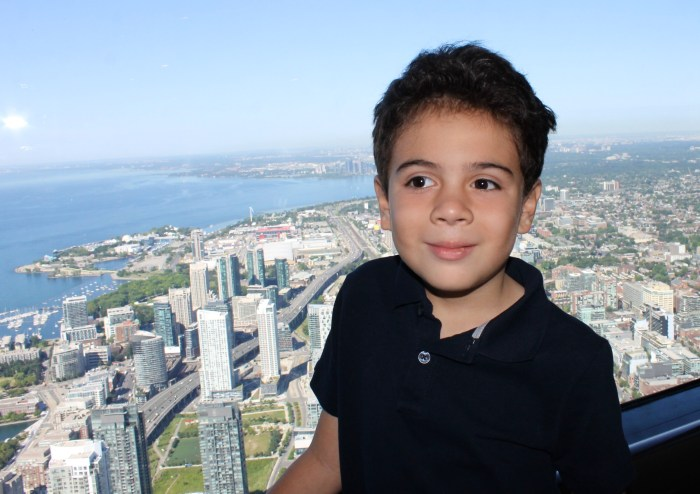 boy and view of Toronto from the CN tower