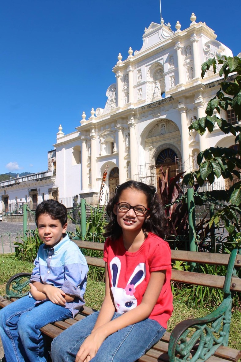 Central Park in Antigua Guatemala with the Cathedral in the background.