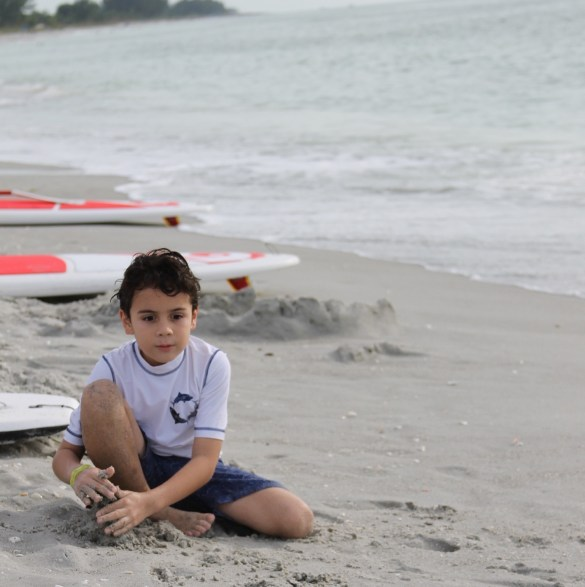 boy on Sanibel beach at South Seas Island Resort