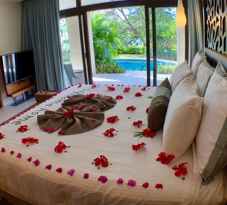 beautiful flower decoration on the bed at Dreams Las Mareas Costa Rica