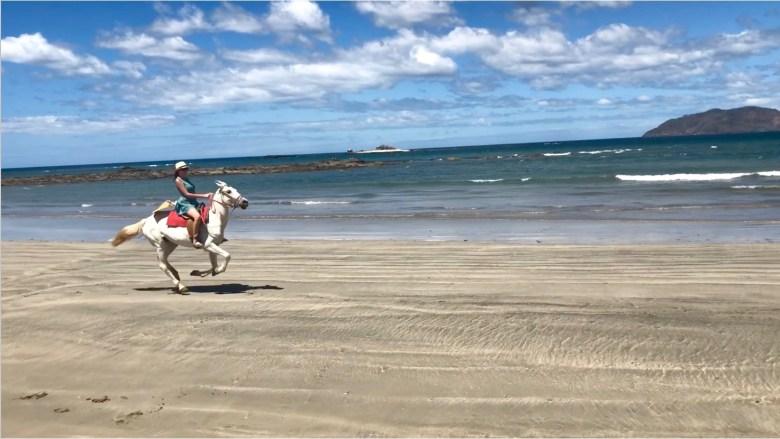 horseback riding on the beach in Playa Tamarindo Costa Rica