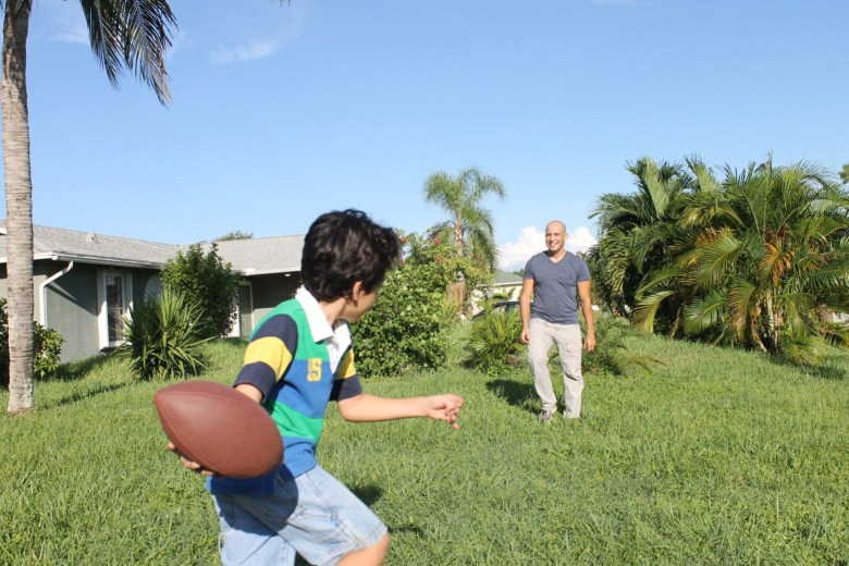 throwing football with dad