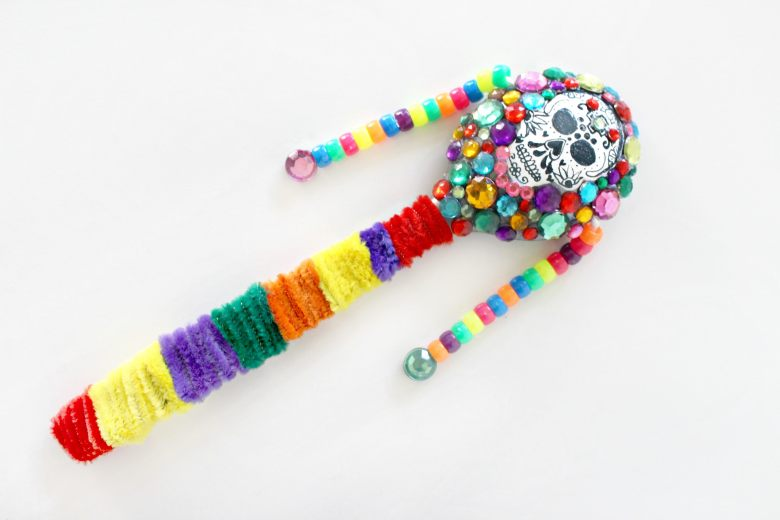 This DIY sugar skull noise maker is a great pipe cleaner Day of the Dead craft for kids.