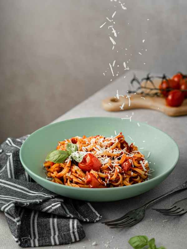 delicious spaghetti with bolognese sauce and parmesan cheese