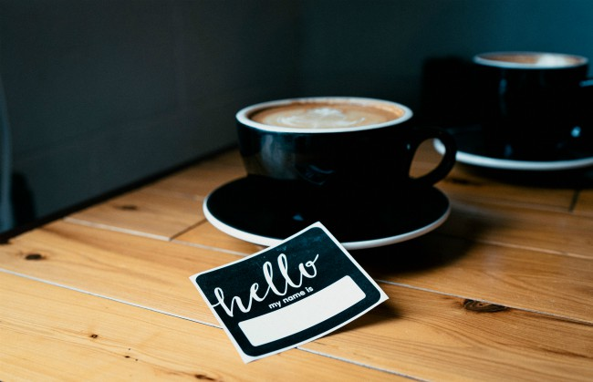 coffee cup near hello nametag business networking