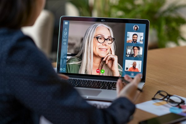 older woman on video call with four other virtual networking