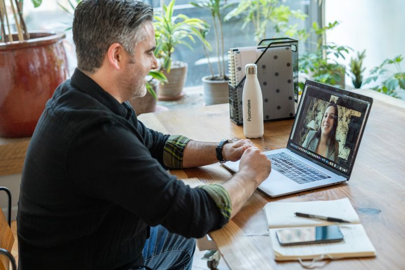 man talking to woman online networking event