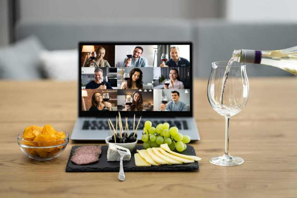 wine and cheese in front of laptop with event attendees | 9 Virtual Event Ideas to Hit Your Business Goals