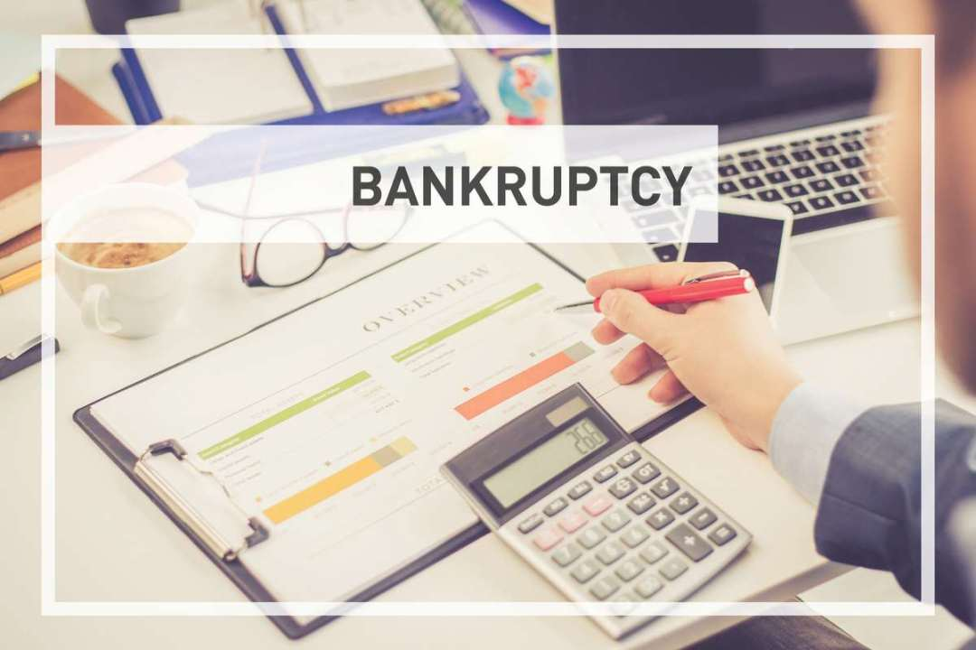 bankruptcy concept desk with calculator
