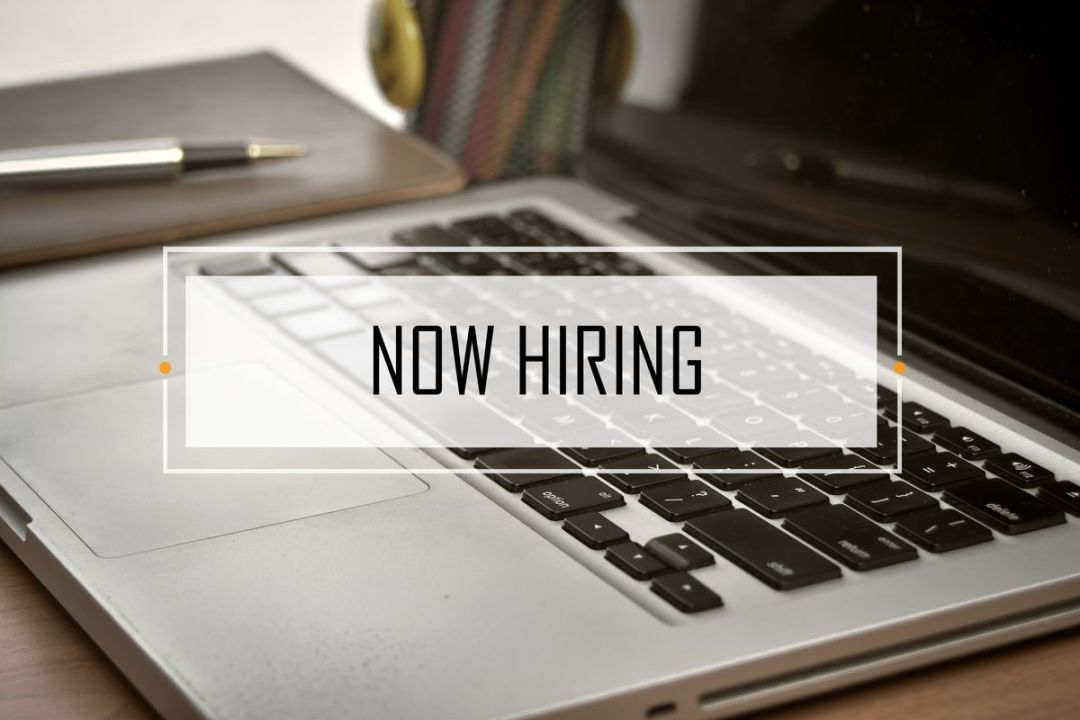 now hiring sign over computer | Small Business Hiring Solutions