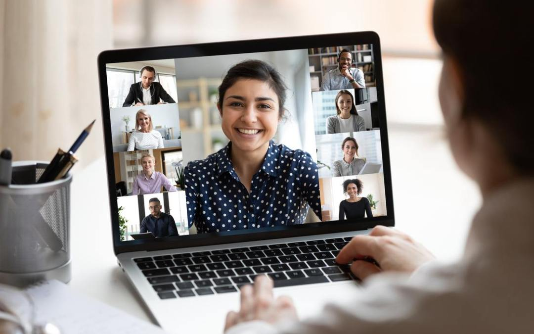 woman holding online meeting with diverse people on screen