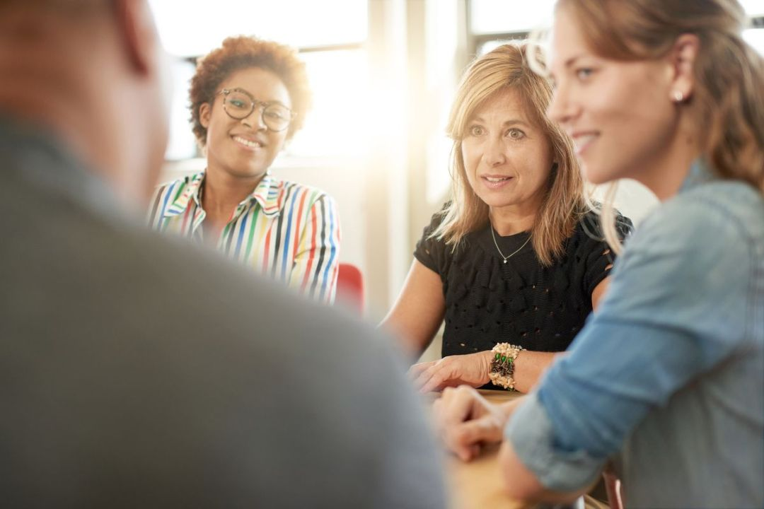 three women networking at table