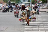 crossing a street in Vietnam, how to cross a street in vietnam, Vietnamese lady crossing street,