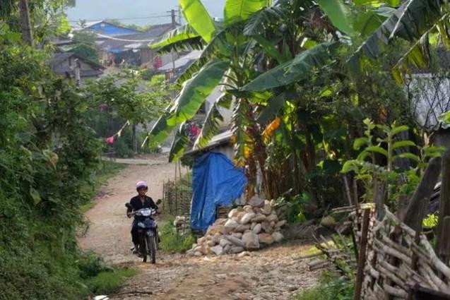 Hmong men on motorbikes, tavan village sapa valley,