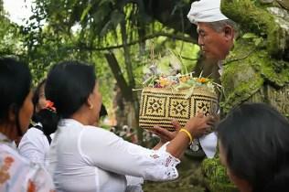 Priest holding worship outside Tampaksiring