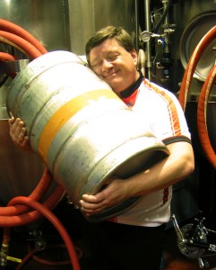Jamie cuddles with a full keg.