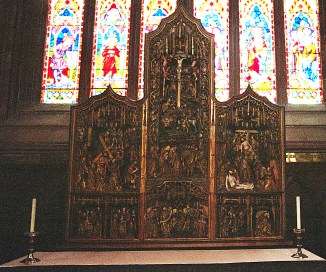 A superb carved triptych at the rear of a chapel altar