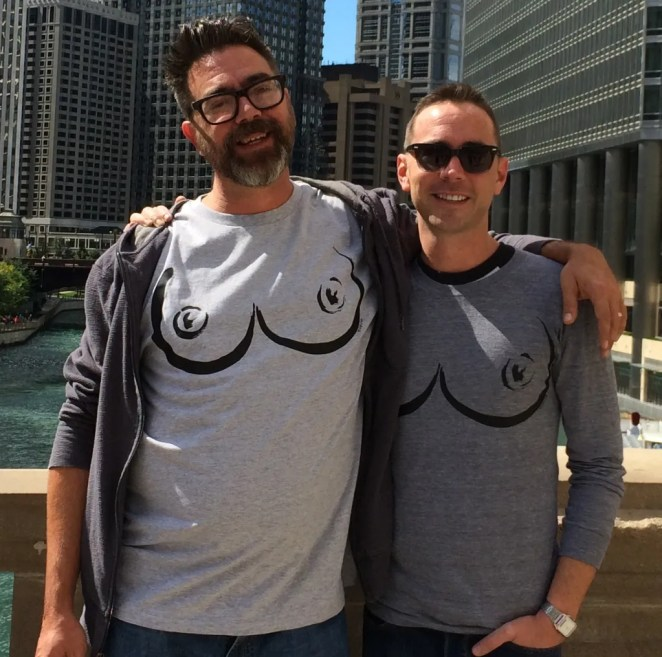 "The two guys are Jerrod Gullett and Travis Johns, both from Proud Pony International, whose film ""The Trouble with Ray"" was an official selection at London's Raindance Film Festival and screened at Chicago's Reeling Film Fest, the Chicago LGBT International Film Festival. They are sporting Thedra's boob shirts, which are now available at Easy. Buy one!"