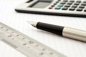 Pen, paper and a calculator to help someone calculate your moving costs.