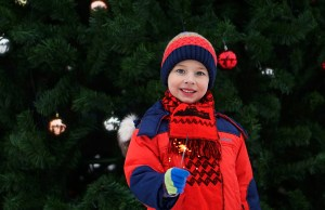A child in front of a Christmas tree