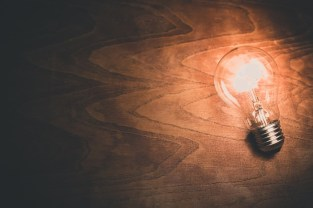A light bulb - electricity is important when thinking about who to notify when you are moving.