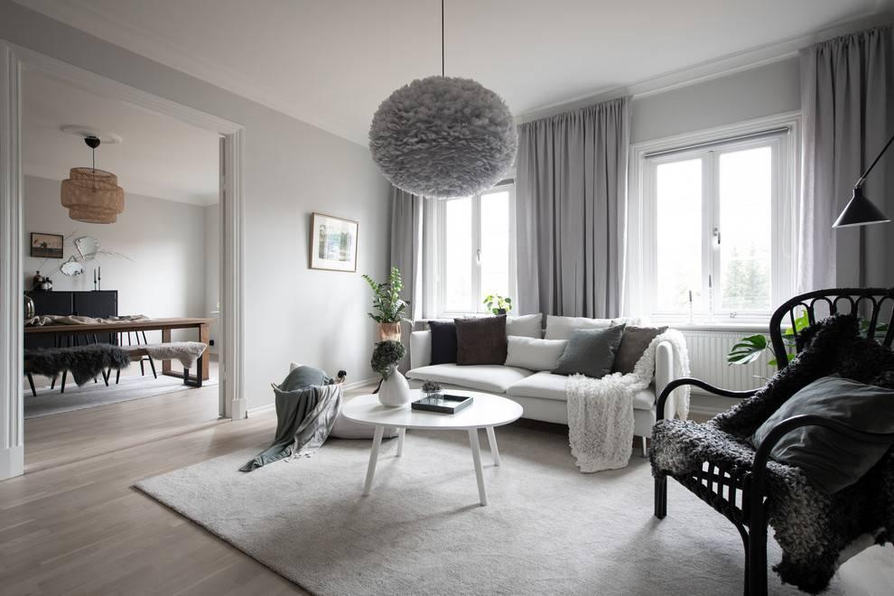 15 sobresalientes diseños de sala de estar escandinavos con un encanto brillante