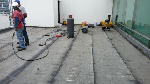 Instalación de Manto Asfáltico Liso BMW
