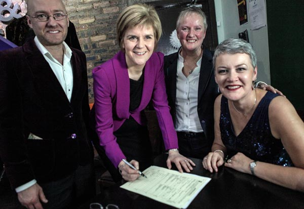 First Minister Nicola Sturgeon and Patrick Harvie witness the first same sex marriage just after midnight in Glasgow, on December 31, 2014