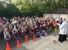 First-Day Blessing. Students gather at the back entrance of the school for Father's first-day-of-school blessing.