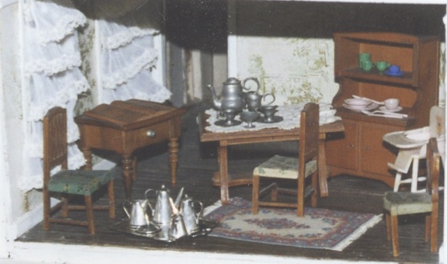 Doll house dining room, with original hutch, tables, chairs, and wallpaper, matching the photo above (Dorothy Angel Tenney)